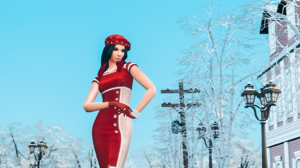 Screen capture of the SIMS game with a brunette in a red beret and dress standing on a street during Winter.