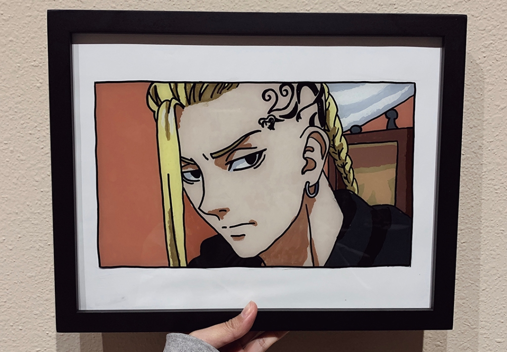"""A glass painting of Draken from """"Tokyo Revengers"""" in a black picture frame."""